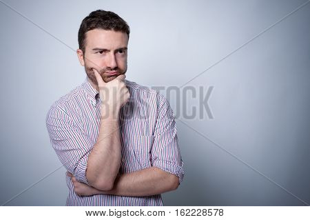 Resigned man face expression isolated on gray background