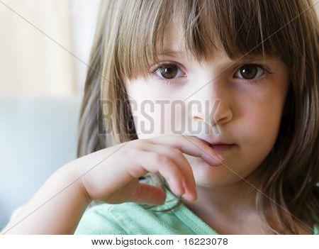 little girl looking nervous