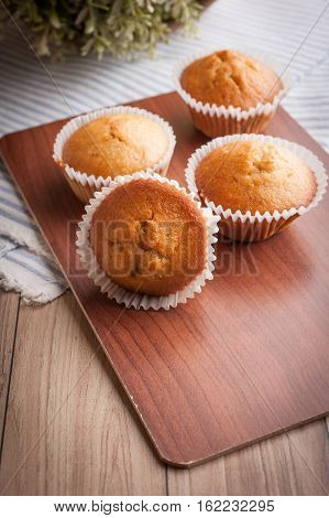 Homemade banana bread on wooden background top view copy space for text