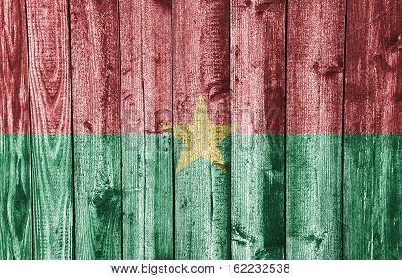 Flag Of Burkina Faso On Weathered Wood