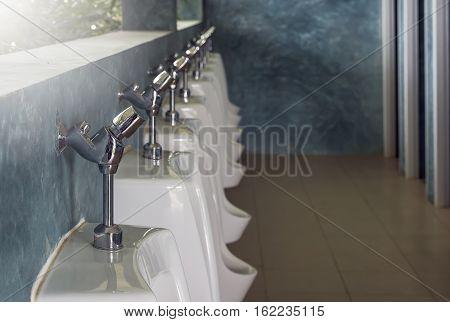 Urinals in public toilet for men onlyshallow DOF