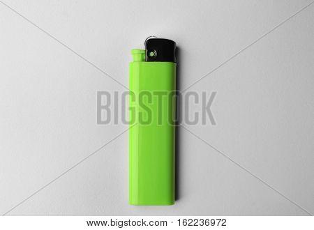 Blank green cigar lighter on white background