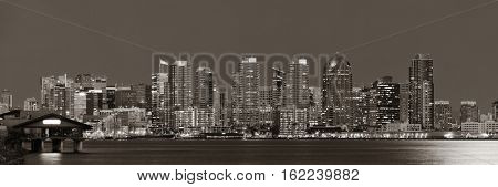 San Diego downtown skyline with moon light over water at night