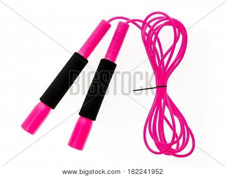 Pink Jump Rope Or Skipping Rope Isolated On White Background.