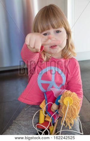 Child Pink Shirt Sitting On Floor Complaining