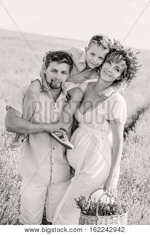 Happy young family outdoors in a lavender field ( black and white )
