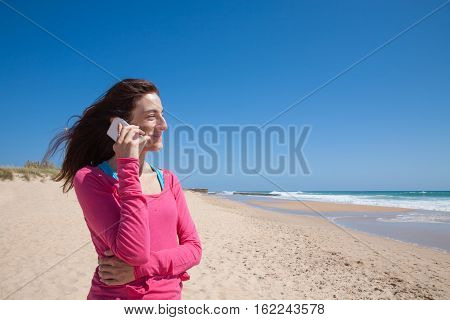Pink Shirt Woman Talking On Mobile At Beach