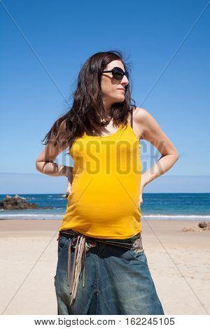 Yellow Shirt Pregnant Woman At Beach