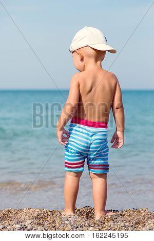 cute toddler boy on the beach in summer
