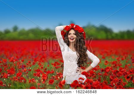 Hair. Beautiful Happy Smiling Teen Girl Portrait With Red Flowers On Head Enjoying In Poppies Field