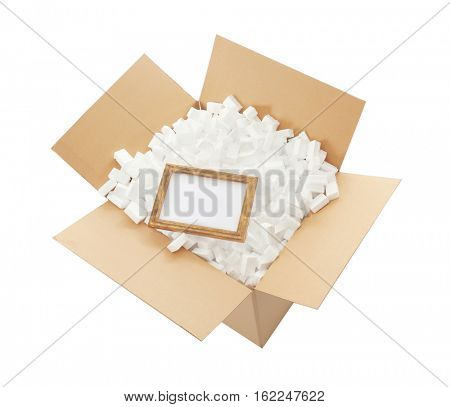 Delivery service concept. Frame in cardboard box full of polystyrene isolated on white