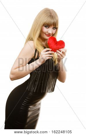 Woman elegant blonde long hair girl dark makeup red lipstick black evening dress holding red heart love symbol flirting on white. Valentines day happiness concept