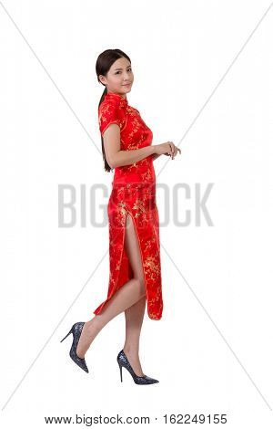 Chinese woman in traditional cheongsam in the new year isolated on white