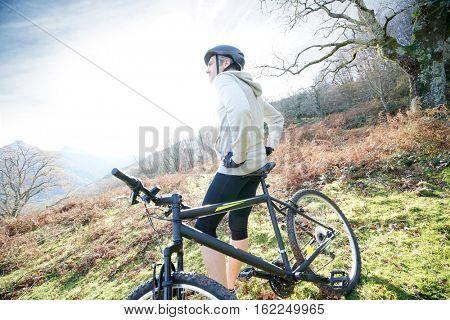 Biker relaxing on bike, admiring scenery