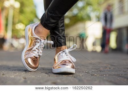 Street style shinny womans shoes in the city