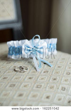 wedding details garter rings, lie on a chair