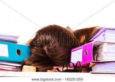 Woman sleeping in office. Young overworked businesswoman or distressed secretary with a lot of documents folders bills on her desk. Business and paperwork. Studio shot on white.