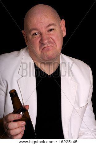 Beer drinker looks dissatisfied with taste and flavor