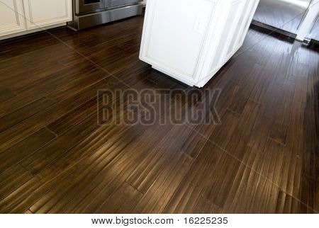 New dark stained hardwood flooring in kitchen area of new home
