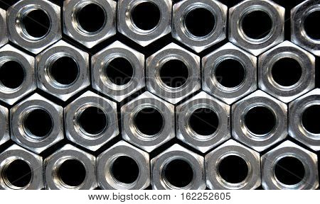 Close up hex nuts put row abstract style