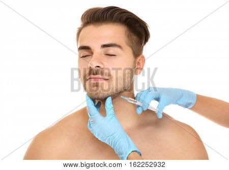 Plastic surgery concept. Man receiving injection in his face
