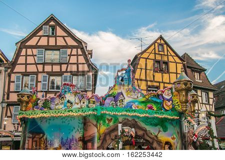 COLMAR, FRANCE - DECEMBER 9, 2016: Traditional Alsatian half-timbered houses decorated in winter holidays in Colmar, France