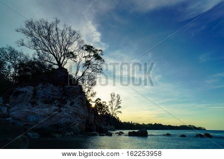 Trees Silhouette at Tanjung Kubong tropical beach with rocks formation located at the northern tip of Labuan Island.It is also the place where the famous and mysterious chimney standing high.
