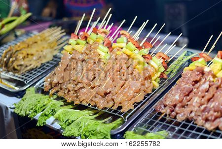 Bar-B-Q or BBQ with kebab cooking. chicken street food in Thailand