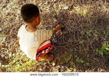 The Boy Were Sitting On The Ground