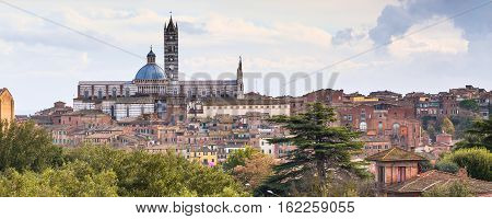 Panorama of old town Siena, Tuscany, Italy with beautiful dome of Siena Cathedral, Duomo di Siena