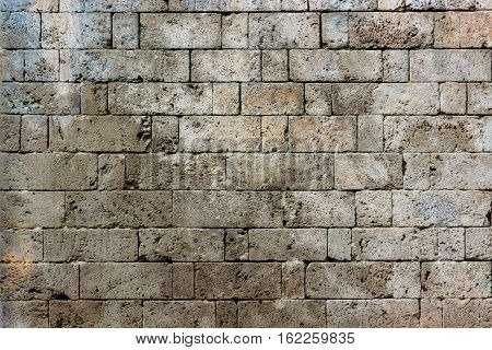 An old ancient stone wall making a pattern