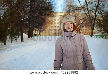 Young Girl In Winter With A Sincere Broad Smile