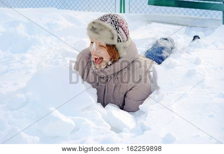 Girl Lying In The Snow Heap