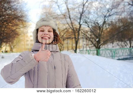 Girl Showing A Thumbsup Gesture