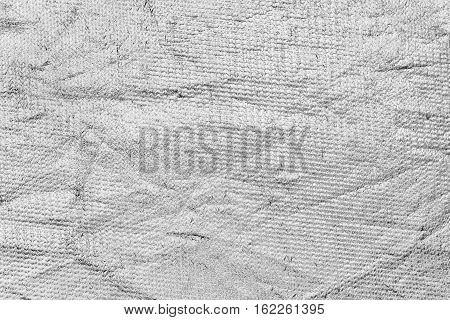 Crumpled texture detail of silver canvas reflector for photographer