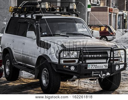 Kazakhstan, Ust-Kamenogorsk, december 12, 2016: Toyota Land Cruiser 80 in the parking. Big powerful suv
