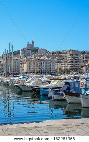 Yachts In The Port Of Marseilles On The Background Of The Church Of Notre Dame De La Garde