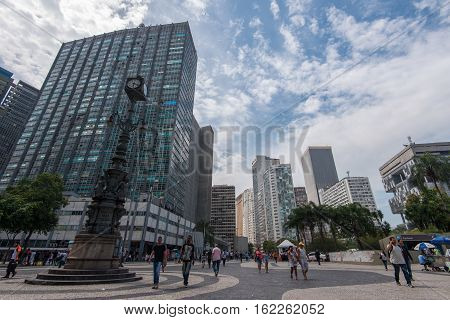 Rio de Janeiro, Brazil - November 22, 2016: Largo da Carioca square in the city center is surrounded by business buildings and is always full of people.