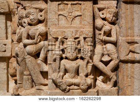 CHITTORGARH, INDIA - FEB 15, 2015: Dance of women near Lakshmi goddess on wall of traditional Hindu stone temple on February 15, 2015. Chitaurgarh has population 117000 and the largest fort in Rajasthan