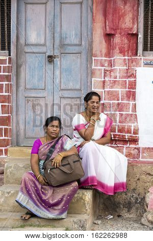 Illustrative image. Pondicherry Tamil Nadu India - Marsh 02 2014. Indian colored house with people walking sitting