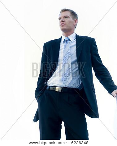 Attractive man wearing shirt tie and business suit.   Large copy space area.
