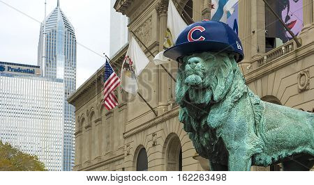 Chicago IL USA October 27 2016: Lion Statue with Chicago Cubs hat. The statue is one of a pair of bronze lions that flank the main entrance of The Art Institute of Chicago.