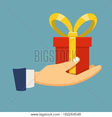 Hand holding a red gift box in flat style design for various holiday illustrations and posters