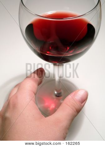 Reaching For Wine Glass