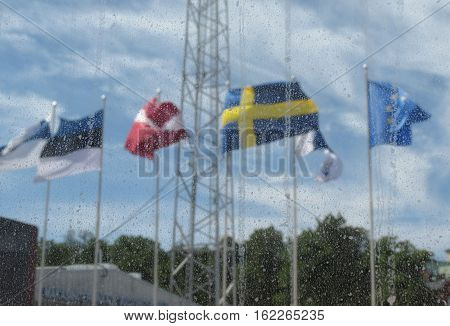 Scandinavian flags (Finland Estonia Latvia Sweden) and UE flag floating in the air
