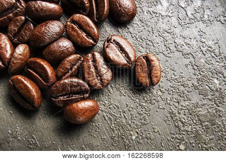 Coffee beans on gray background on close up