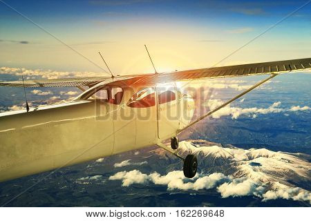 propeller plane flying over high mountain for traveling theme