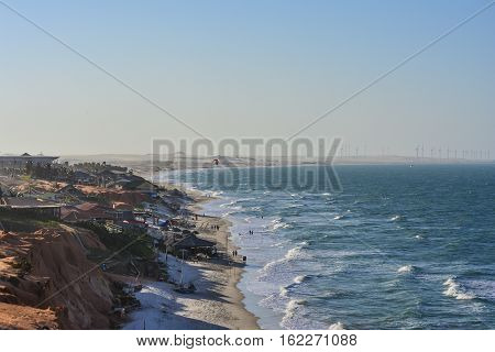 Canoa Quebrada beach viewed from above in the afternoon.