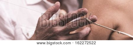 Man's Hand Undressing Woman