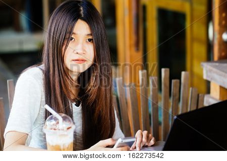 Business Woman Using Portable Laptop Computer With Phone Communication